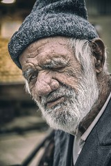 The Man of the Socks (Roberto Pazzi Photography) Tags: cap portrait people street eye travel old man iran face asia beard kerman elderly elder culture place photography glance one person head shoulders outdoor nikon