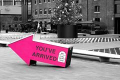 You've Arrived (Geoff Henson) Tags: arrow sign yard fountain bench colourpopping selectivecolours london kingscross geoffhenson nikond5500 nikon50mmf18g tree christmastree