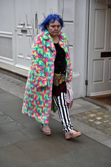 Coat of many colours (jeremyhughes) Tags: london street city woman portrait urban colours colors stripes stripy bluehair style individual eyecontact people nikon d750 nikkor 2470mmf28 eccentric