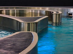 Every Pool Has a Silver Lining (Steve Taylor (Photography)) Tags: architecture silver blue grey metal chrome water newzealand nz southisland canterbury christchurch northnewbrighton curve ripple shiny reflection swimmingpool taioraqeiirecreationandsportcentre