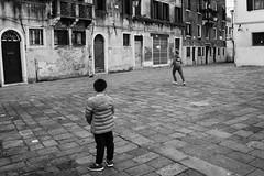 On the sideline   In disparte (Roberto Spagnoli) Tags: football streetphotography fotografiadistrada sport piazza campo venice venezia italy biancoenero blackandwhite bw boys game ball people