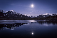 Rocky Mountain Stillness (Christina Angquico) Tags: canada banff alberta vermillionlakes moon night nikon reflection longexposure christinaangquico
