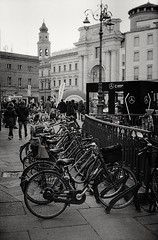 Parma - Bikes (Delta 400 in Finol) (tjshot) Tags: film analog vintage mood monochrome black white self develop home diy konica autos2 rangefinder 35mm 135mm ilford delta400 finol pyro stain developer process parma italy bike bikes city center people historical tones