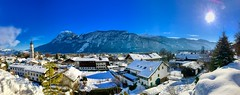 Sunny winter's day panorama of Kiefersfelden in the river Inn valley with Kaiser mountains, Bavaria Germany (UweBKK (α 77 on )) Tags: sunny winter day snow ice cold blue sky white clouds river inn valley kaiser mountains alps alpen kaisergebirge zahmer tree forest building house schnee panorama landscape scene scenery scenic view kiefersfelden bavaria bayern germany deutschland europe europa iphone