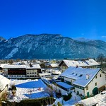 Sunny winter's day panorama of Kiefersfelden in the river Inn valley with Kaiser mountains, Bavaria Germany thumbnail