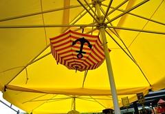 Schirm unter Schirm / Umbrella beneath shield (Lichtabfall) Tags: ostsee balticsea poel inselpoel schirm regenschirm umbrella anker anchor gelb yellow kirchdorf