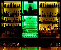 Pick Your Poison (Karen_Chappell) Tags: bar hotel travel usa chicago bottles glass glasses green yellow light lights interior reflection silhouette booze drink alcohol stilllife