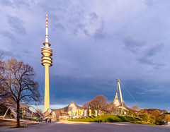 Towering over the sunset (Geoff Eccles) Tags: 1972 bavaria bayern coubertinplatz deutchland germany muenchen munich olympiahalle olympiapark olympiaturm olympics schwimmhalle spring clouds colour light shadows sunset trees