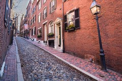 Going Back in Time (Rebecca Leyva) Tags: road rocks colorful tourism unique neighborhood flag gaslamps brick landscape travel urban beaconhill newengland quant charm historic acorn cobblestone massachusetts boston street