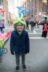 He's got a poodle crown on his head. (kuntheaprum) Tags: chinatownboston chinesenewyearcelebration yearofthepig sony a7riii tamron 2470mm f28 festival parade dragon firework