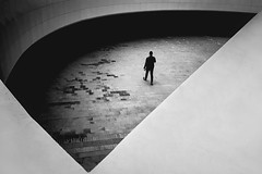 Darkness to Darkness (Mohammad Dadsetan) Tags: architecture monochrome perspective bnw light shadows man portrait highangle street human minimal