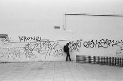 Punk (ewitsoe) Tags: analog analogue bnw blackandwhite documentary ewitsoe journalist monochrome nikon nikonfm2 street warszawa erikwitsoe film poland urban warsaw hp5 filmy man standing praga cityscape scene cinematic