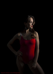 Anastasia-1438 (Dana Brady) Tags: redbodysuit bodysuit nikon nikond7100 red one light moody