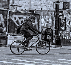 "Biker Pedaling His Way on Grand and Essex Street LES (nrhodesphotos(the_eye_of_the_moment)) Tags: dsc22213001084 ""theeyeofthemoment21gmailcom"" ""wwwflickrcomphotostheeyeofthemoment"" monochrome impressionistic outdoors essexandgrandstreets les manhattan nyc mailbox spokes wheels bicycle biker crosswalk graffiti metal wood streetlights bike road street man helmet streetscene"