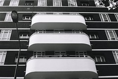 Art Deco balconies (Jim Davies) Tags: bloomsbury university olympus om10 slr 50mm ferrania p30 film filmfilmforever analogue photography veebotique 35mm 35mmfilm blackandwhitefilm bw blackandwhite monochrome uk england 2018 may london artdeco architecture apartments flats housing deco