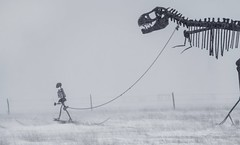 before dogs... (Alvin Harp) Tags: sculpture manandtrex southdakota i90 february 2019 winterscene roadsideattraction dinosaursculpture sonyilce9 fe70200mmf28 gmoss2x bw monochrome blackandwhite mono alvinharp
