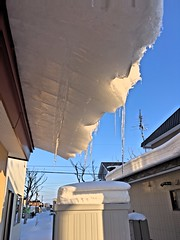 Ice on the Roof (sjrankin) Tags: 18february2019 edited kitahiroshima hokkaido japan snow ice weather roof sliding icicles sky hdr
