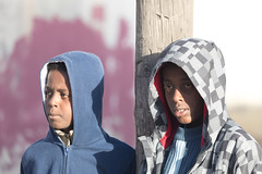 Boys with Hoodies, Irbid, Jordan (mistermacrophotos) Tags: people boys hoodies hoods waiting refugee real life middle east film shoot canon 5d mk4 african youth cold winter chequered blue red pole location alkarmel