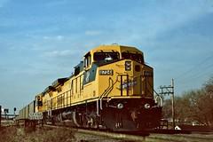 CNW 8704 west in Northlake, Illinois on March 14, 1995. (soo6000) Tags: c449w ge cnw chicagoandnorthwestern cnw8704 8704 grandavenue searchlightsignal northlake illinois coaltrain coal wkjrx freight manifest railroad fallenflag provisoyard