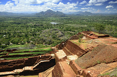 Ancient fortress ruin, Sigiriya (Butterfield & Robinson 1966) Tags: famousplace fort oldtown rockformation srilanka tropicalclimate unescoworldheritagesite ancient asia blue cliff cloud famous forest green hill history landmark landscape lanka lankan large lion mountain mountains nature old past place rock ruin sigiriya sky stone travel tree