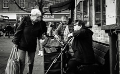 Shoppers (Bury Gardener) Tags: monochrome mono burystedmunds bw blackandwhite britain suffolk streetphotography street streetcandids snaps strangers candid candids people peoplewatching folks nikond7200 nikon england eastanglia 2018 cornhill