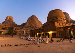 Khatmiyah mosque and the tomb of Hassan al Mirghani at the base of the Taka mountains, Kassala State, Kassala, Sudan (Eric Lafforgue) Tags: adultsonly africa architecture builtstructure colorimage copyspace culture day death dusk faith grave groupofpeople hassanalmirghani horizontal islam islamic kassala khatmiyah menonly mosque mudbrick northsudan photography placeofworship pray prayer praying religion religious spirituality sudan sudan181269 sufi sufism tariqa tomb traveldestinations kassalastate sd