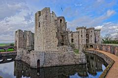 Raglan Castle (Croydon Clicker) Tags: castle monument tower battlement keep moat water reflection wall bridge footpath flag ruin desolation sky cloud raglan wales monmouthshire