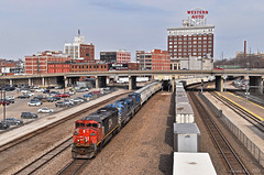 Westbound Grain Train in Kansas City, MO (Grant Goertzen) Tags: cn canadian national cefx bnsf railway railroad locomotive train trains west westbound grain unit freight kansas city union station missouri western auto sign cowl barn