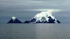 Snow Capped Island Mountains along Antarctica Peninsula (Joseph Hollick) Tags: island snowcovered mountain mountains antarctica antarcticapeninsula