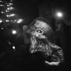 silent-night (kaumpphoto) Tags: rolleiflex 120 tlr ilford bw black white window display santa eye cap hat street minneapolis beard moustache christmas holiday lights xmas creepy