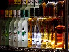 Liquid Gold (Steve Taylor (Photography)) Tags: bottles gold donq rum puertorican coco limon mojito cristal drink alcohol cocktailbar shelf brown dark green white yellow glass metal newzealand nz southisland canterbury christchurch glow translucent