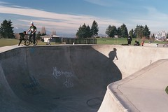 Skatepark Shadow (. o 0 Sam 0 o .) Tags: nikon n80 f80 fuji fujifilm superia superia400 grain noise film bmx skatepark jeffersonskatepark beaconhillskatepark circularpolarizer shadow seattle washington washingtonstate