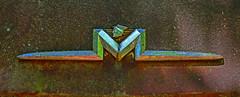 M (davidwilliamreed) Tags: old rusty crusty metal chrome mercury car auto automobile emblem rust patina textures abandoned neglected forgotten weathered weatherbeaten oxidized oxidation oldcarcity whitega bartowcounty decay