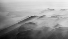 Learning to Fly - Number 2 (photofitzp) Tags: alps austria bw blackandwhite fog haze italy mist mountains shadows sunset surreal