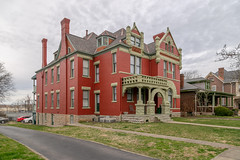 Curtis House — Lexington, Kentucky (Pythaglio) Tags: house dwelling residence lexington kentucky unitedstatesofamerica us romanesque twostory brick ornate latevictorian stone rusticated stonework richardsonian fayettecounty roundarched columns capitals floral voussoirs stainedglass turret finials porch curtis