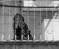 Flower Pot. By Haim Nachman Bialik, (Israel's national poet) (ybiberman) Tags: israel jerusalem meahshearim purim celebration ultraorthodoxjews jews ultraorthodox feast girl sitting staring watching people portrait candid streetphotography bw balcony bars