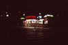You're in the place they call the Nightside (Magnus Bergström) Tags: fujivelvia100f fuji fujichromevelvia100frvp slide slidefilm 35mm canonae1 canon sweden sverige västra götaland göteborg vasaplatsen night dark darkness neon kiosk food light