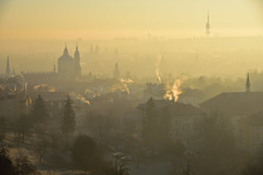 Winter morning in Mala Strana - 2 of 2 (Pavel's Snapshots) Tags: prague praha czech czechrepublic morning sunrise dawn sunlight fog mist haze yellow europe european city town urban houses roofs towers house roof tower spire spires winter televisiontower church temple old ancient medieval historic historical nikon nikkor d750 light travel landmark cityscape view aerial rooftop panorama panoramic smoke street 85mm capital yellowfog supernatural building buildings dramatic valley gold golden heritage architecture oz