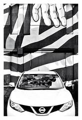 The hand of fate (leo.roos) Tags: parking parkeerplaats car auto reflection weerspiegeling noiretblanc dehopman straatkunst streetart streetwiseproject urbanartstudio terraart tobiasbeckerhoff karskibeyond michadebie bierbrood saidkinos sjorskouthoofd iameelco zoetermeer makroplanart250 makroplanar502zf a7rii carlzeissmakroplanar502 zf cz darosa leoroos muurschildering mural muralism graffiti graphitti grafitti wallart graphiti