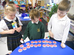 Teen Numbers: The kindergartners love hiding the worm behind an apple and guessing which number has it hidden.  This helps them practice numbers up to 20. (st.brigid2) Tags: march