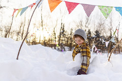 His happy place (Elizabeth Sallee Bauer) Tags: feburary active boy bright child childhood cold colorful extremeweather family fantasy flags fun happiness imagination kid makebelieve outdoors outside playing pretend snow snowfort together winter youth