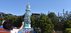 Riding the Zephyr (earthdog) Tags: 2018 nikon nikond5600 d5600 18300mmf3563 disneyland disneyvacation anaheim travel vacation themepark amusementpark vacation2018 ride goldenzephyr disneycaliforniaadventure amusementride lighthouse tree sky