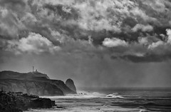 'Storm Warning' (Canadapt) Tags: coast ocean water wave lighthouse village beach clouds storm bw portugal canadapt