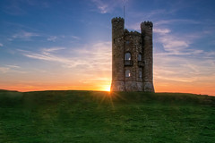 The sun peeping from behind Broadway Tower (Roland B43) Tags: cotswolds uk broadway sunset sunrays