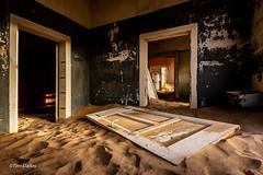 Door (Tim-Dallos) Tags: africa namibia desert deserted diamond mining ghost town d750 ruined haunted crumbling shadows light paint peeling rays eerie 1930s nikon sun sand doorway room doors