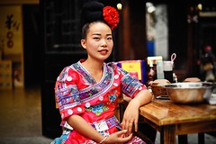 A portrait of Miao's girl (snowpine) Tags: people portrait girl china chinese guizhou street streetportrait