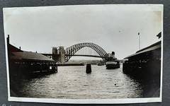 Harbour Bridge and ferry, Sydney Harbour, N.S.W.  - circa 1937 (Aussie~mobs) Tags: sydneyharbour sydneyharbourbridge ferry 1937 vintage australia newsouthwales circularquay