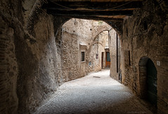 Casperia, Central Italy (Claudio_R_1973) Tags: arch architecture construction building masonry wall bricks pavement road shadow corner street passage house home casperia centralitaly sabina reatino village urbanlandscape urban