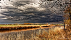 Squashing The Land (Alfred Grupstra) Tags: nature landscape water outdoors sky scenics cloudsky lake ruralscene reflection autumn tree river beautyinnature grass season nonurbanscene sunset reedgrassfamily tranquilscene 90