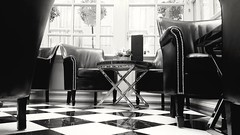 Art Deco cocktail bar..... (markwilkins64) Tags: themilestonehotel kensingtonhighstreet london artdeco bar cocktailbar mono monochrome bw blackandwhite markwilkins windows baytrees chairs tables marblefloor check lounge cocktail christmasday kensington